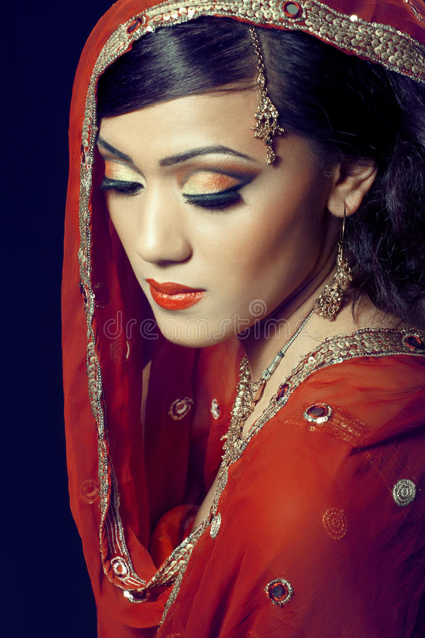 Beautiful indian girl with bridal makeup royalty free stock photo