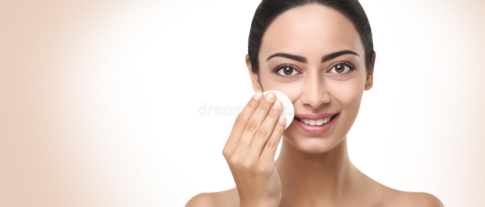 Beautiful indian girl with perfect skin, face cleaning stock image