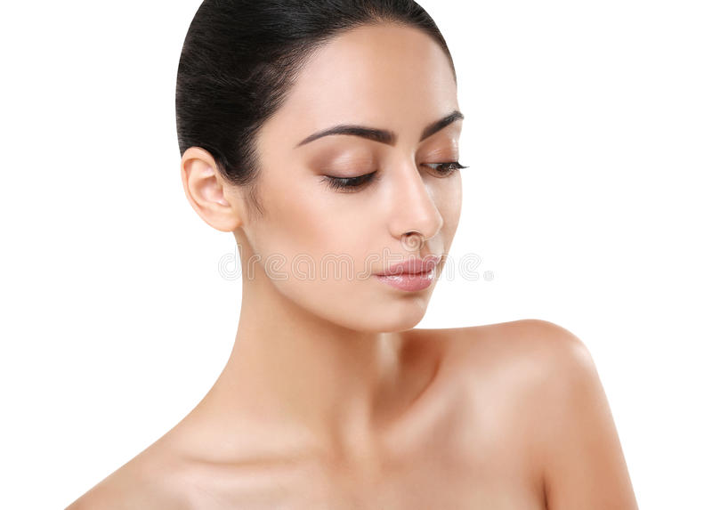 Beautiful indian girl with perfect skin looks down stock image