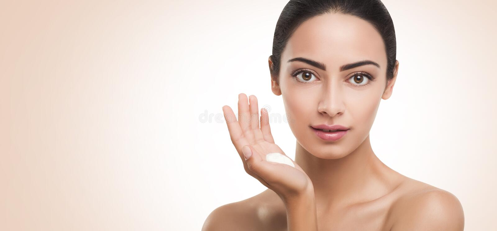Beautiful indian girl with perfect skin, face cleaning stock images