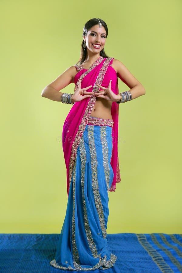 Beautiful indian young brunette woman dancing royalty free stock photos
