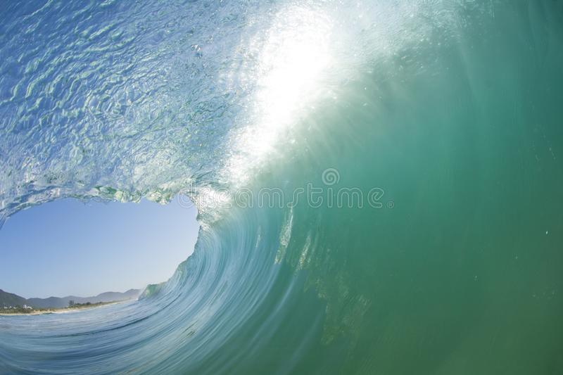 Inside out view of a wave breaking at Campeche beach in Florianopolis Brazil stock images