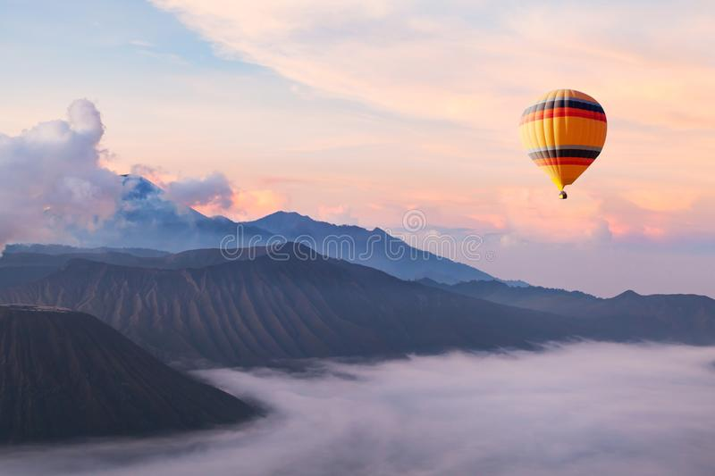 Beautiful inspirational landscape with hot air balloon flying in the sky, travel royalty free stock images