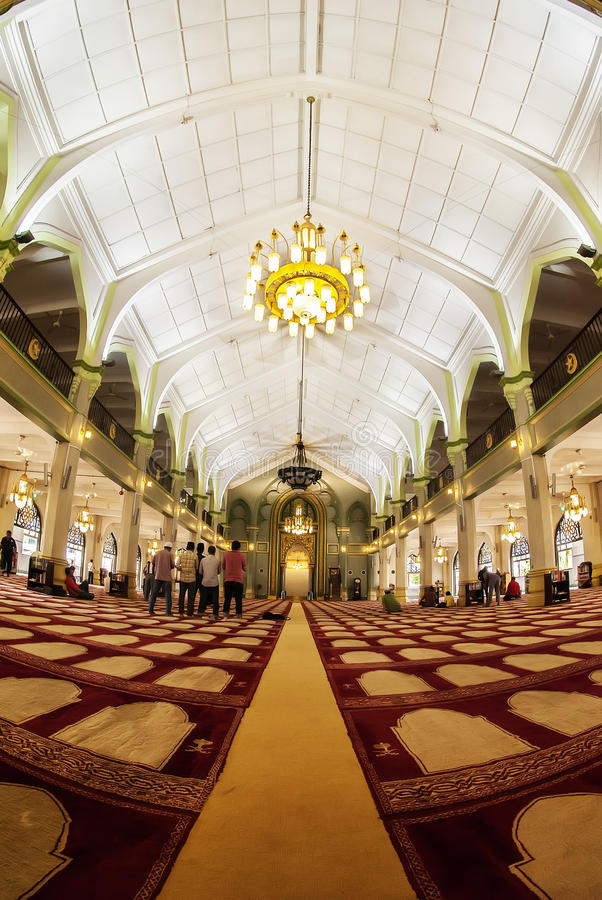 Beautiful Interior Design of Royal Mosque, Singapore. Interior view of Royal Mosque, Singapore with some Muslims make a prayer royalty free stock images