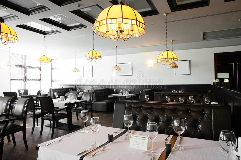 Beautiful interior of modern restaurant. Modern european restaurant with nice and bright interior royalty free stock images