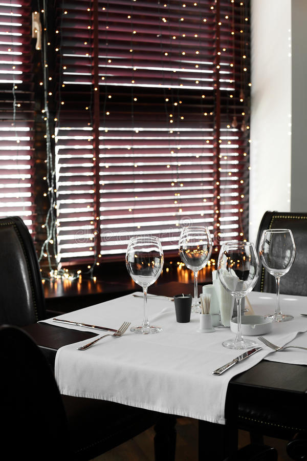 Beautiful interior of modern restaurant. Modern european restaurant with nice and bright interior royalty free stock photography