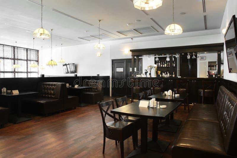 Beautiful interior of modern restaurant. Modern european restaurant with nice and bright interior royalty free stock photos