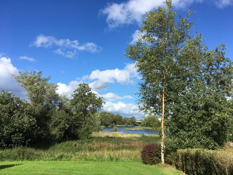 Summer landscape with view on river Erne. Beautiful Irish landscape in Co Cavan on a summer sunny day, Ireland stock photography