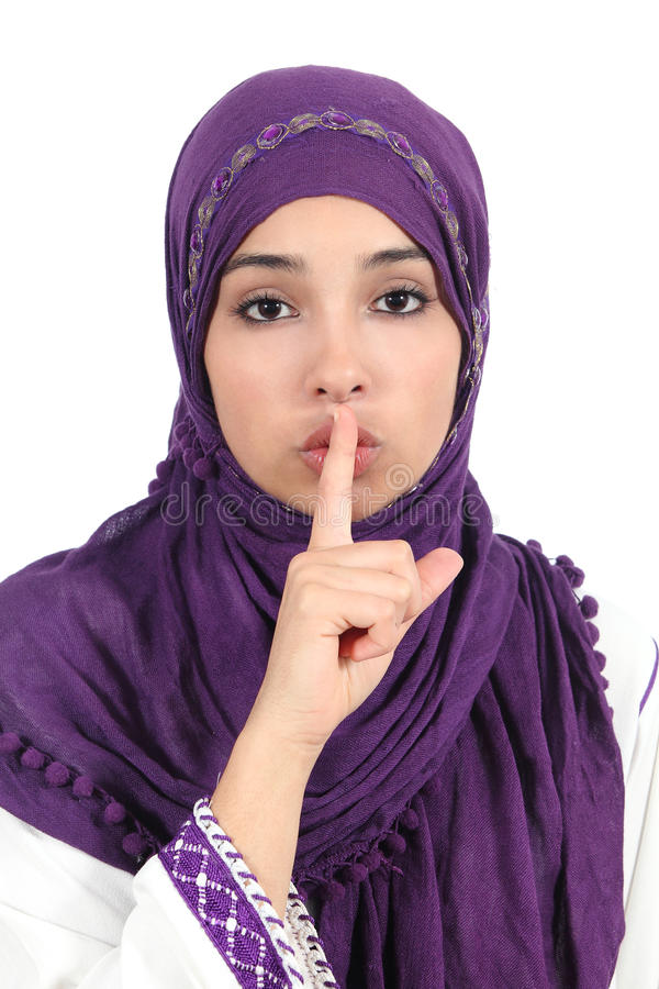Beautiful islamic woman wearing a hijab asking for silence royalty free stock photography