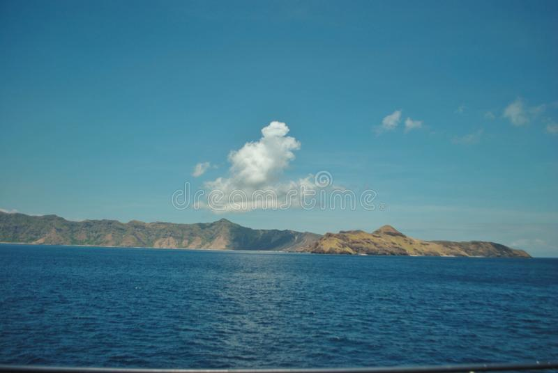Beautiful island beach. View of tropical beach with blue sky In Labuan Bajo, Indonesia stock photo