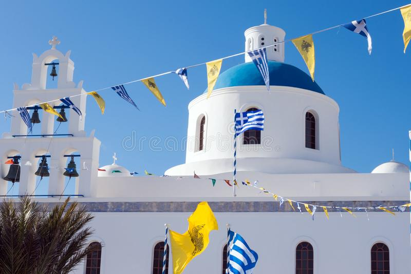 Beautiful island of Santorini, Greece. White Church with a blue dome in the village of Oia on the island of Santorini. royalty free stock images