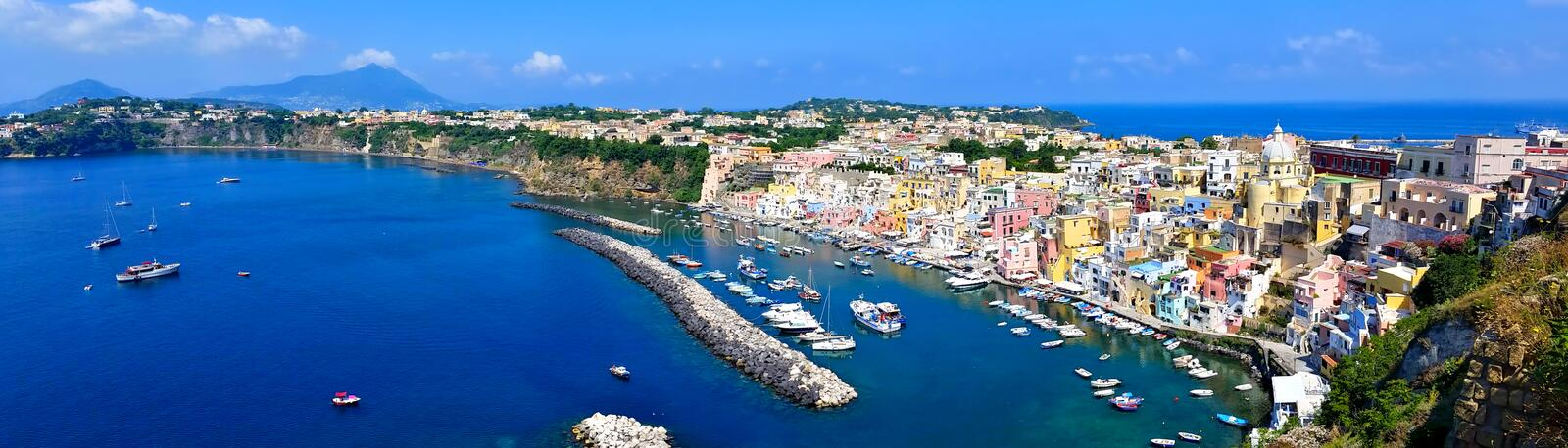 Beautiful island town in Italy, panoramic aerial view of harbor and colorful pastel buildings of Procida stock photography