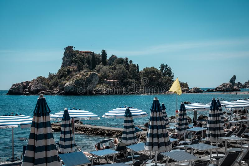 The beautiful isola bella in Taormina with some nice beach stock photography