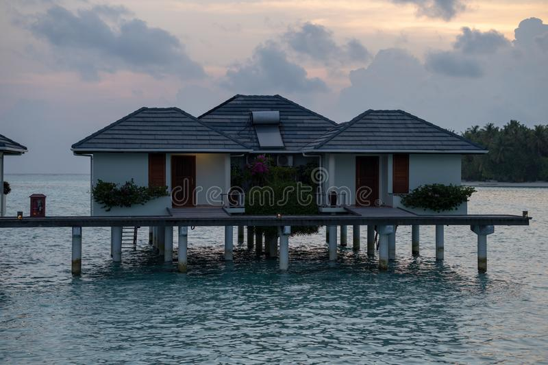 Beautiful isolated luxury water bungalows Maldives in the blue green ocean of the maldives royalty free stock photography