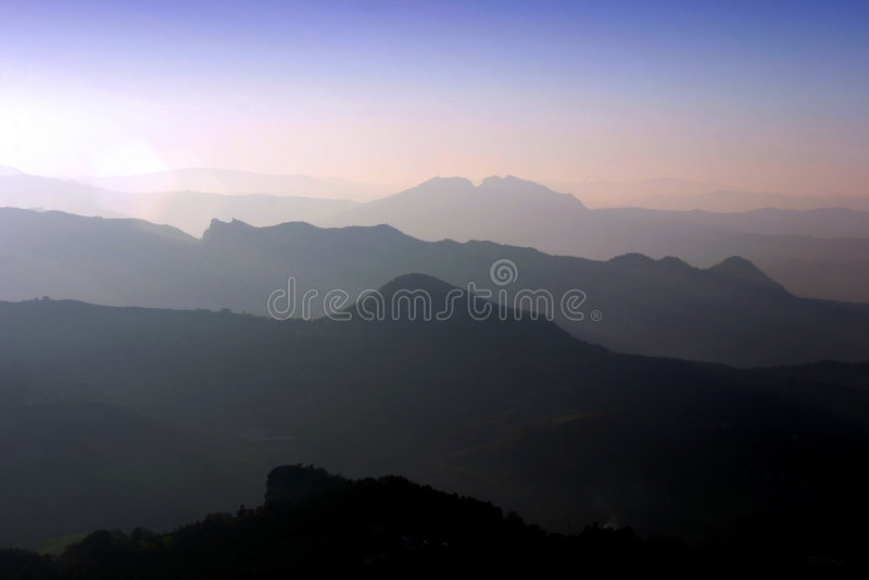 Beautiful italian landscape at dusk. Separate layered italian landscape at dusk in Marche Region royalty free stock images
