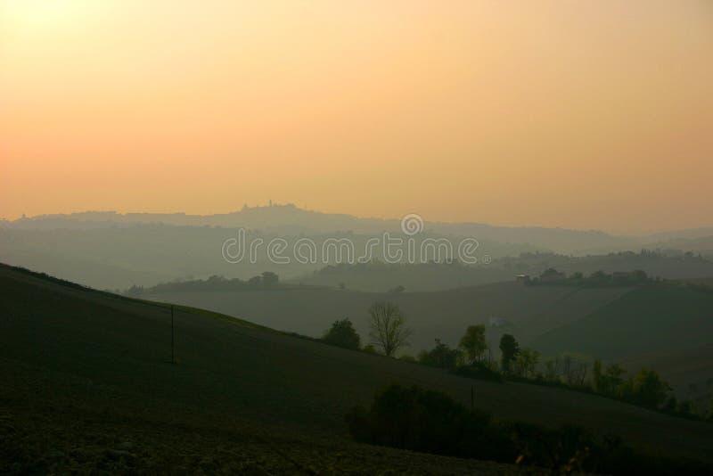 Beautiful italian landscape at dusk. Separate layered italian landscape at dusk in Marche Region royalty free stock photo