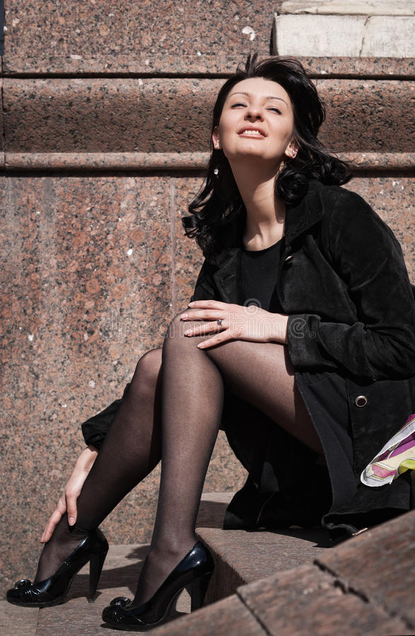 Download Beautiful Italian Woman Sitting On Steps Stock Image - Image: 26507603