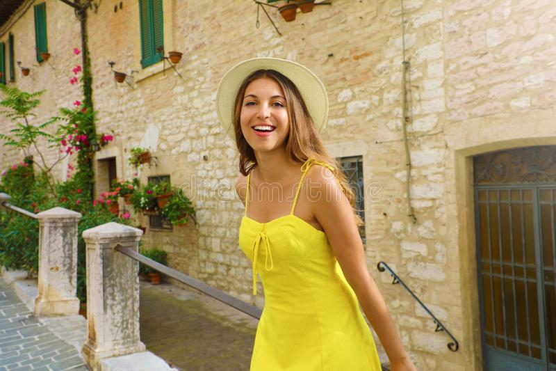 Beautiful Italy. Attractive young woman visiting old medieval town in Tuscany, Italy royalty free stock images