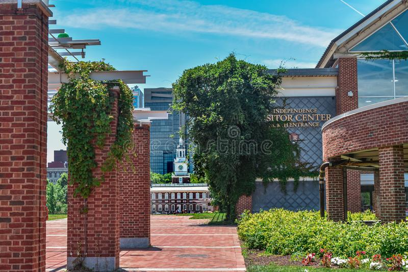 Ivy draped over bricks of Independence Visitor Center Philadelphia, Pennsylvania with Independence Hall in the background. Beautiful ivy draping over brick