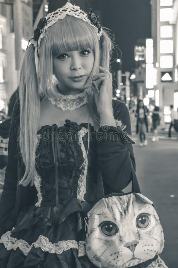 Beautiful Japanese girl in a maid costume in Tokyo stock photography