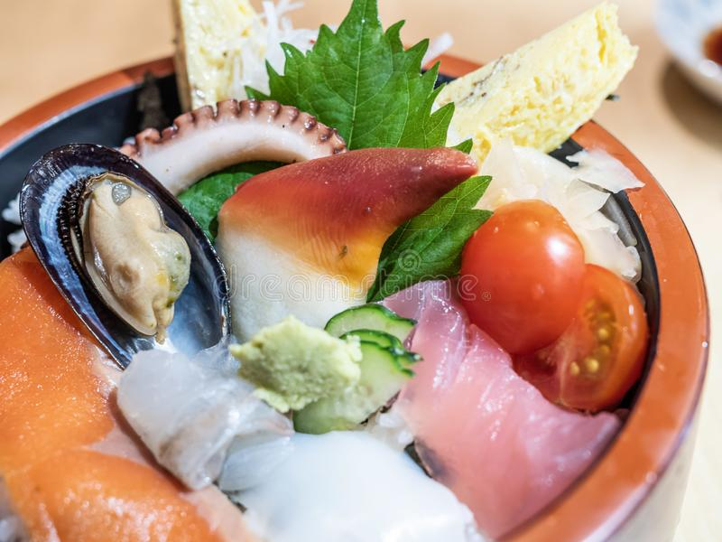 Delicious Japanese Sashimi Don. Beautiful Japanese rice bowl with variety of fresh seafood and a chunk of wasabi called Sashimi don stock images