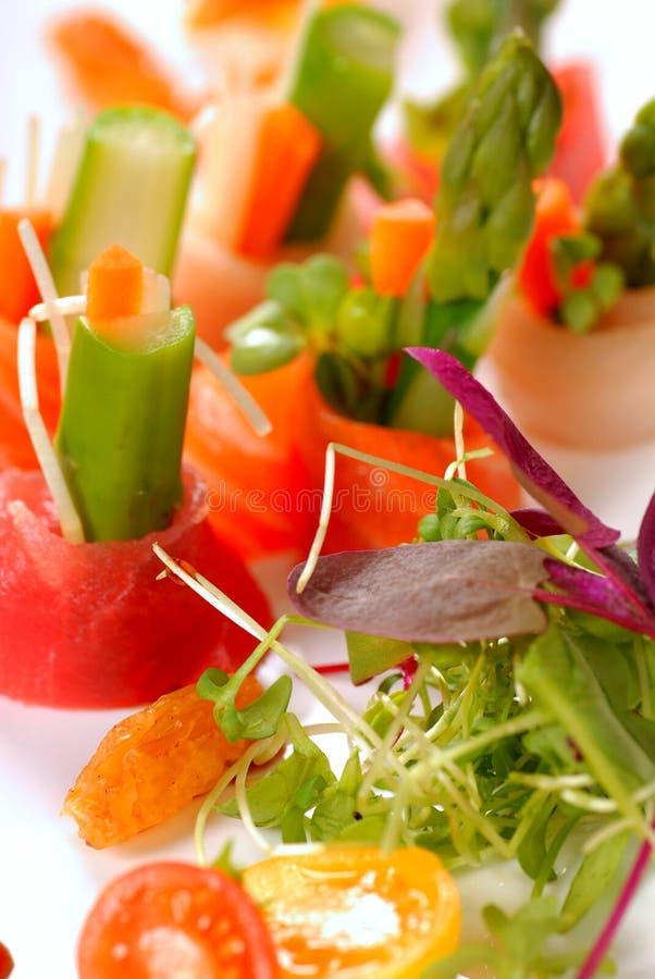 Beautiful Japanese sashimi on a white plate. Variety of fresh japanese sashimi on a white plate royalty free stock images