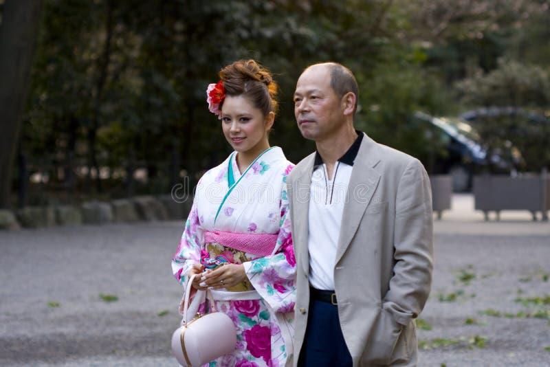 Beautiful Japanese woman kimono man suit royalty free stock images