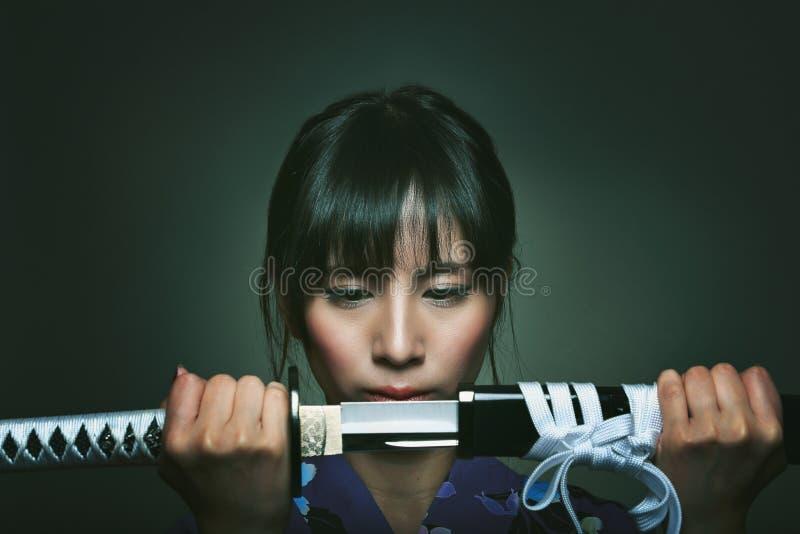Beautiful japanese woman with samurai sword stock images