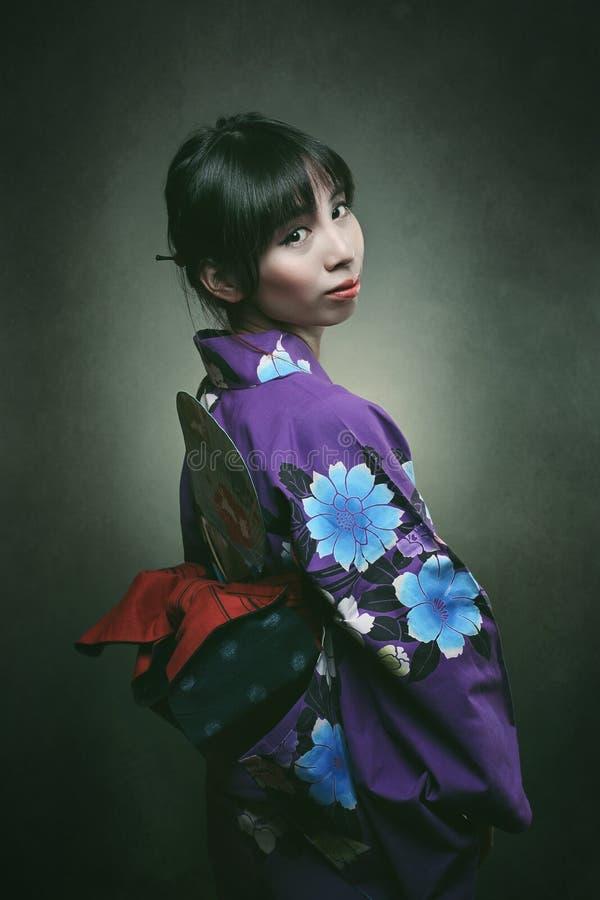 Beautiful japanese woman in traditional kimono royalty free stock photo