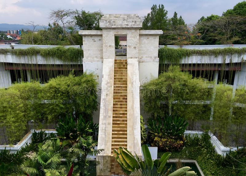 Beautiful Javanese style garden with greenery and plenty of trees & plants. This garden is built at the entrance of a luxury spa resort hotel in Yogyakarta with