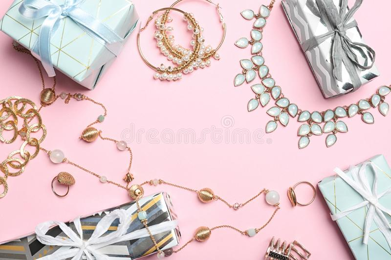 Beautiful jewelry and gift boxes on color background. Space for text stock photos