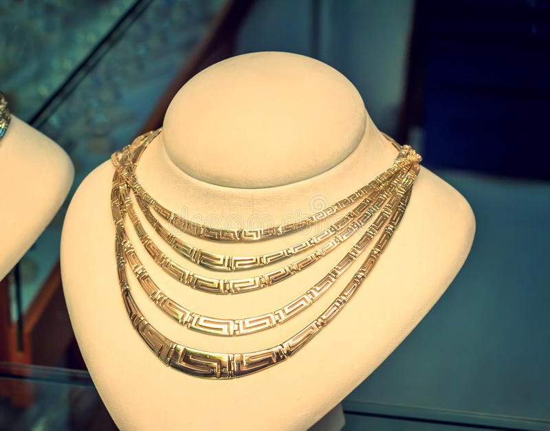 Beautiful Jewelry - Gold Necklace On The Mannequin. Stock Photo ...
