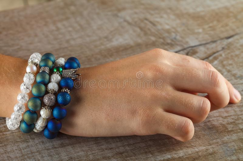Beautiful jewelry made of natural stones and exquisite accessories on a woman`s hand royalty free stock photo