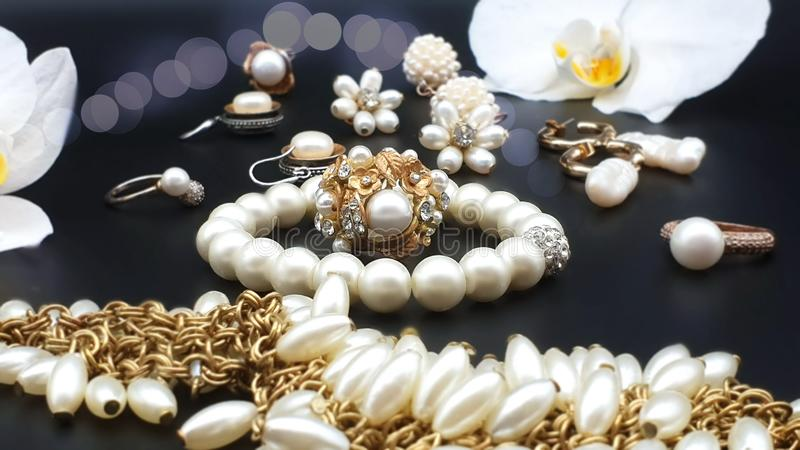 Beautiful jewelry white pearl  set  for woman and girl necklace earrings  bracelet   earring rings on black gold silver  backgroun. Beautiful jewelry white pearl stock photos