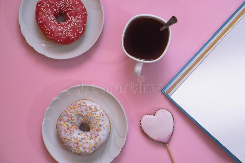 Beautiful juicy donuts with coffee in plates on a decorative tray. February valentine`s day greeting card. background kitchen. Beautiful juicy donuts with coffee stock images