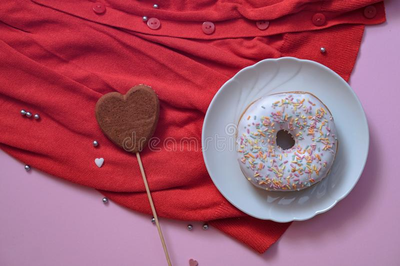 Beautiful juicy donuts with coffee plates on a decorative tray. February valentine`s day greeting card. background for kitchen. Beautiful juicy donuts with stock photo