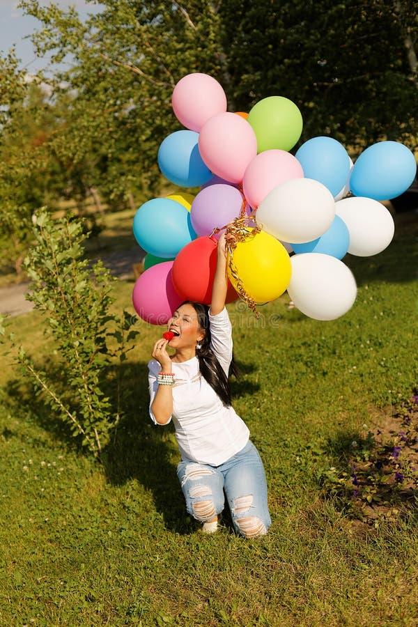 Beautiful kazakh girl with balloons stock photo
