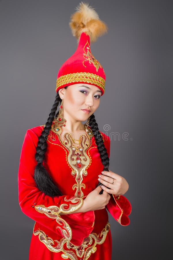 Beautiful kazakh woman in national costume– stock image royalty free stock photo