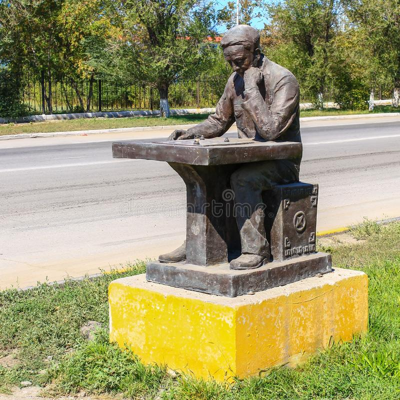 Detail view on Monument of a lonely sitting Chess Player. The Person Thinking about next steps. Located in Temirtau, Kazakhstan  royalty free stock images