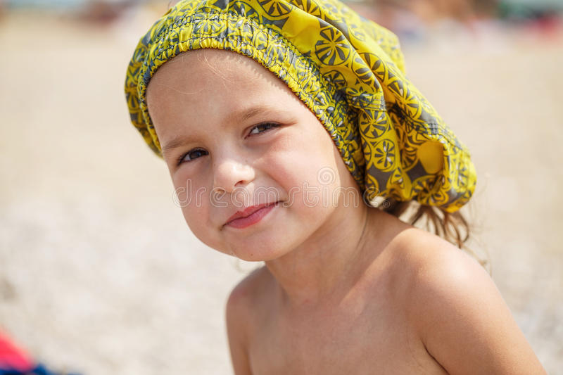 Beautiful kid on the beach. Beautiful baby resting on the beach near the sea royalty free stock photography