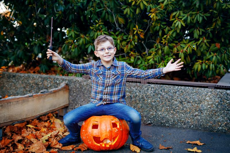 Beautiful kid boy in costume as a magician. Happy healthy child celebrating Halloween. Boy with glasses outdoors on. Beautiful kid boy in costume as a magician stock photos
