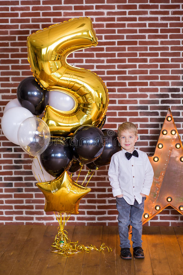 Beautiful kids, little boys celebrating birthday and blowing candles on homemade baked cake, indoor. Birthday party for stock images