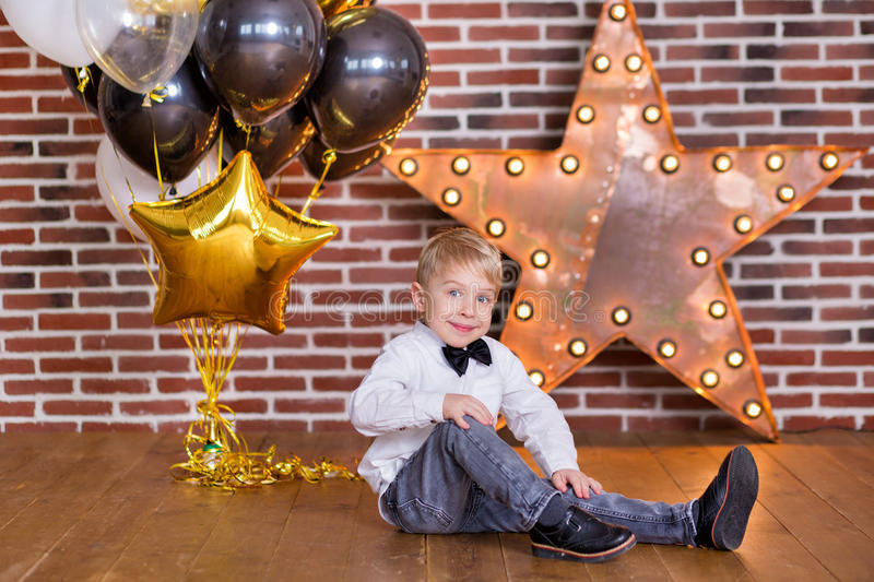 Beautiful kids, little boys celebrating birthday and blowing candles on homemade baked cake, indoor. Birthday party for. Beautiful kids, little boys celebrating royalty free stock photo