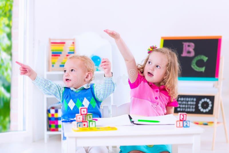Beautiful kids at preschool painting stock photography