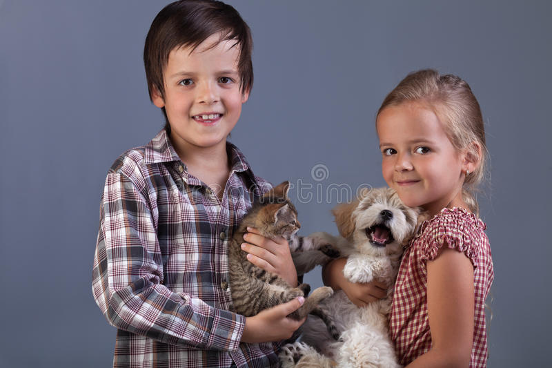 Beautiful kids with their lovely pets. Portrait royalty free stock images