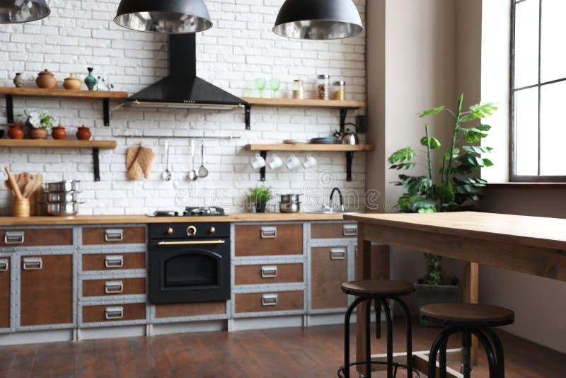 Beautiful kitchen interior with new furniture stock photo