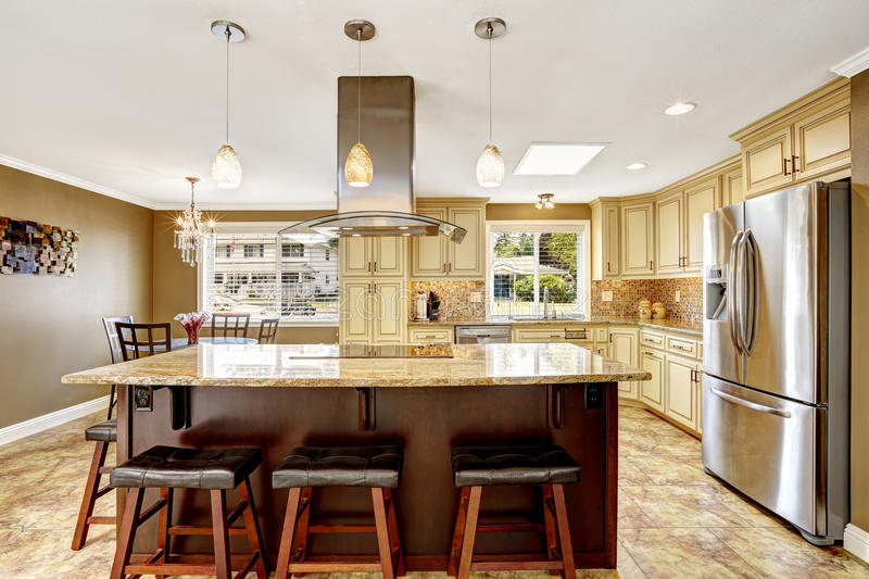 Beautiful Kitchen Island With Granite Top And Hood Stock
