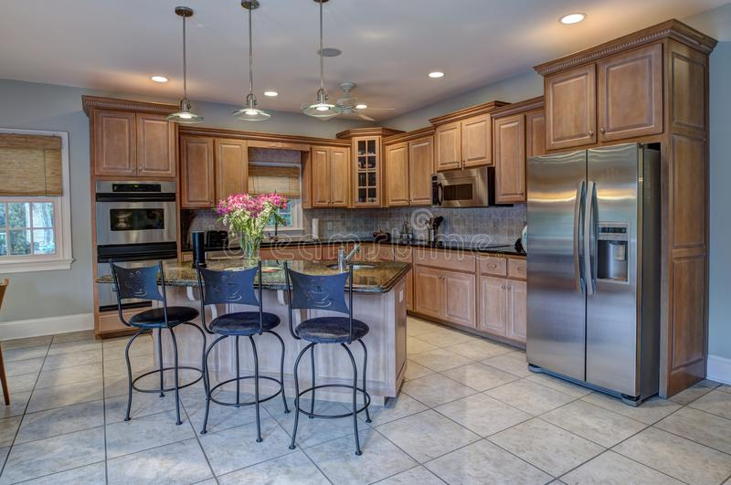 Beautiful kitchen with island and stainless steel appliances stock photos