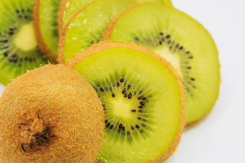 Beautiful kiwi fruit slices background. Beautiful kiwi fruit slices isolate on white background stock images