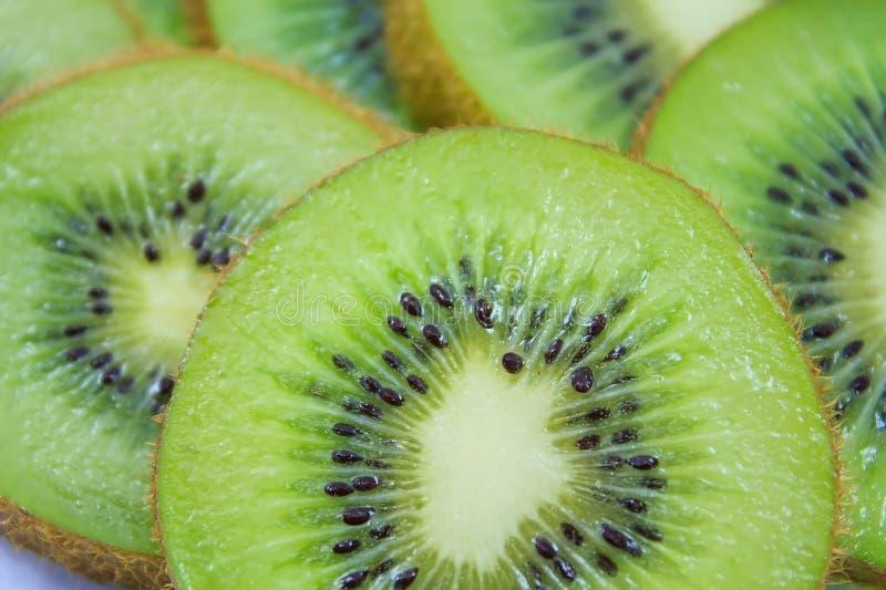 Kiwi fruit slices background. Beautiful kiwi fruit slices background stock photos